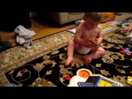Ezra masters the puzzle